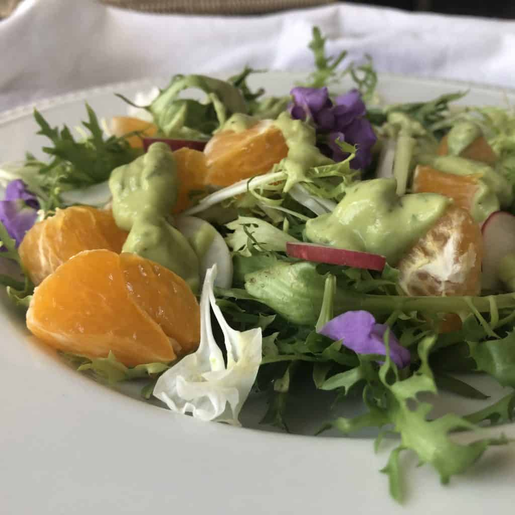 Frisee & Citrus Salad with a drizzle of avocado dresssing