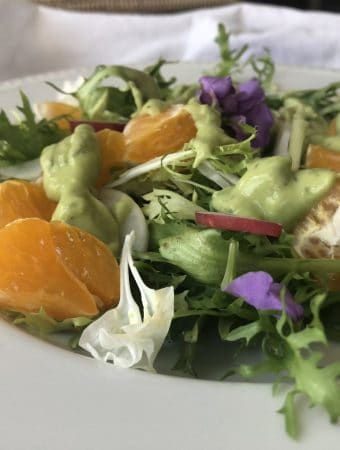 Frisee & Citrus Salad with a drizzle of avocado & tahini dresssing
