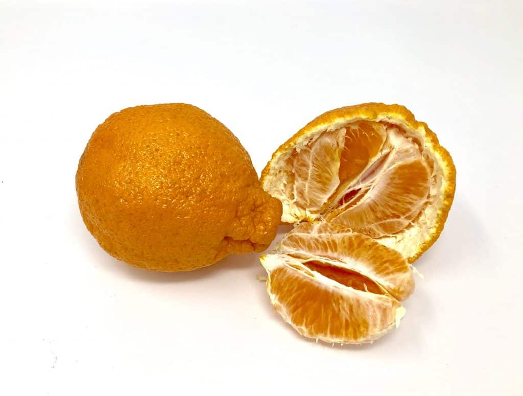 2 sumo citrus - 1 half peeled open