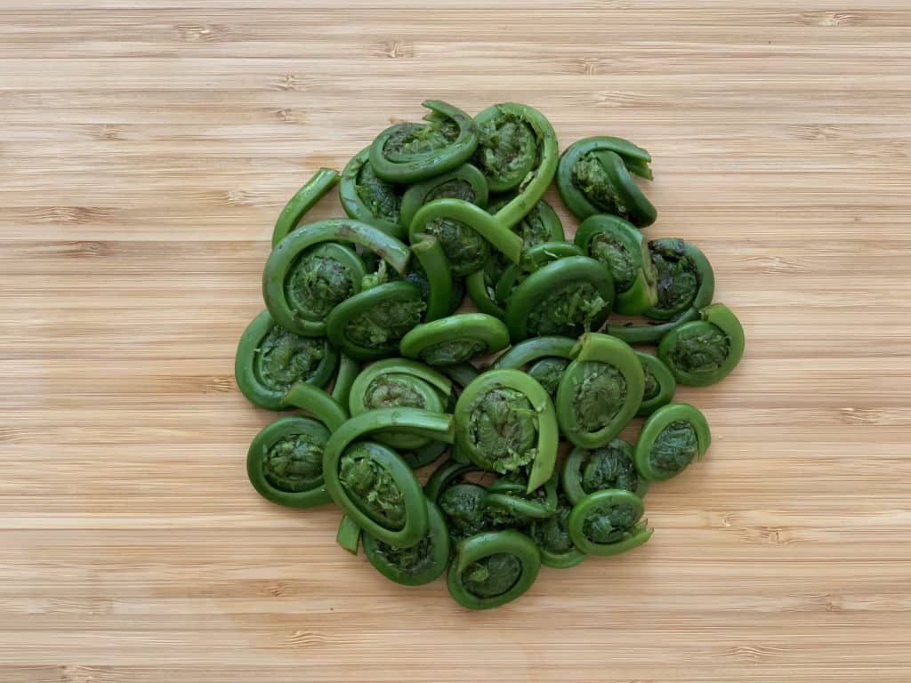 Fiddleheads cleaned & trimmed on a cutting board