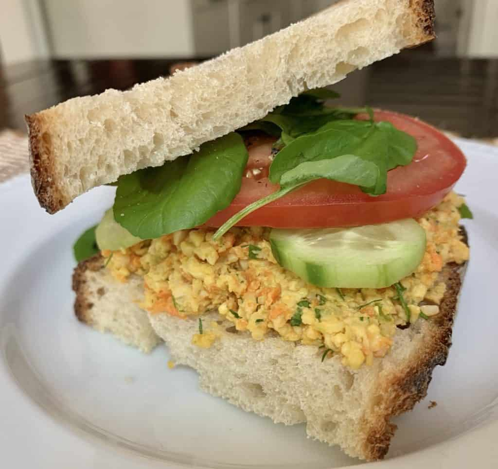 "Tempeh ""tuna"" salad on toasted country sourdough bread with sliced cucumber, tomato & watercress"