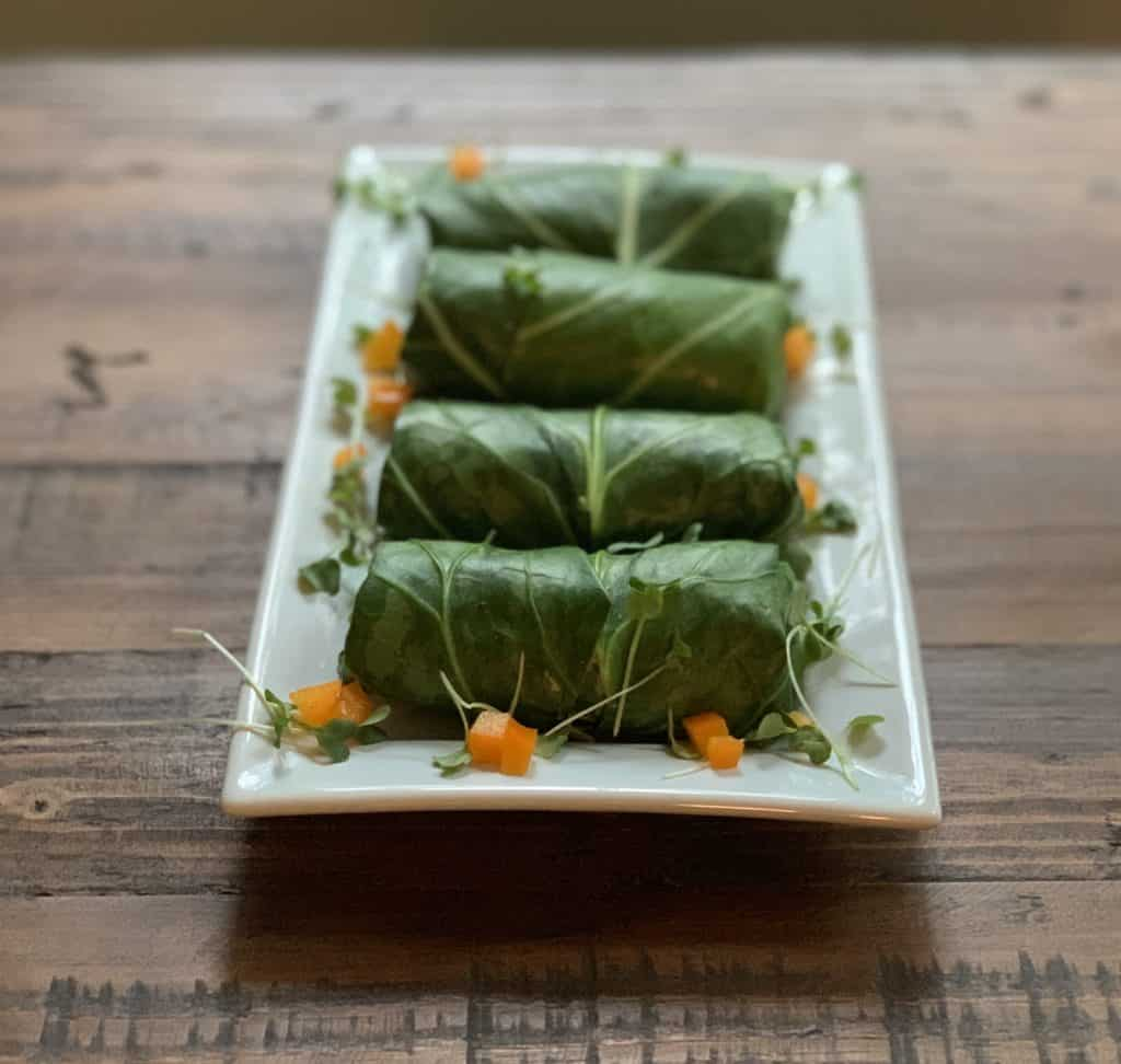 stuffed collard green wraps plated