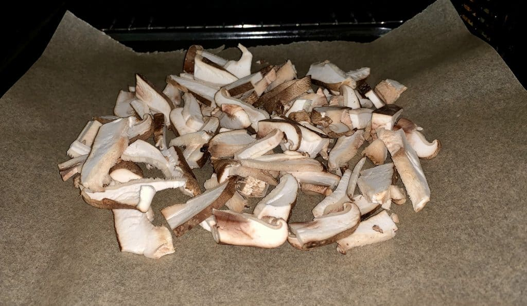 Sliced shiitake mushrooms on parchment paper