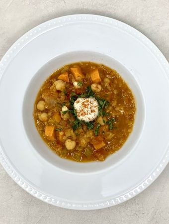 Sweet Potato, Chickpea and Red Lentil Soup is a hearty vegan soup topped with cashew cream & harissa