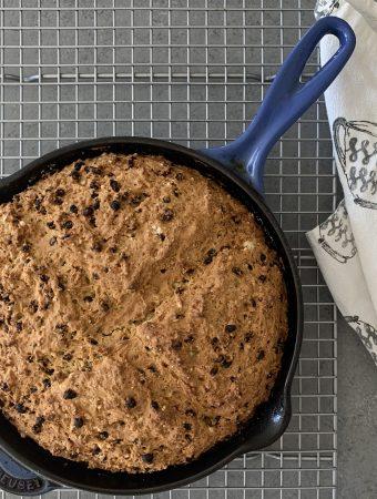 Vegan Irish Soda Bread cooked in a blue cast iron skillet