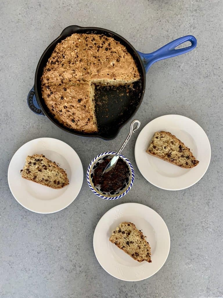 Skillet Irish Soda Bread sliced and ready to serve on plates with fig spread