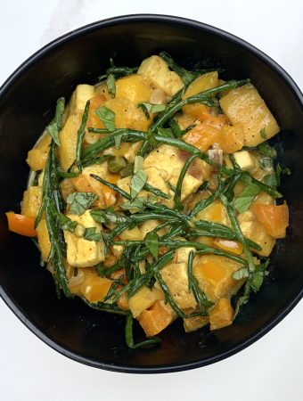 Mango Thai Tofu plated in a black bowl