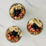 3 Lemon Chia Pudding with Berries, Bananas & Nuts in glass serving bowls