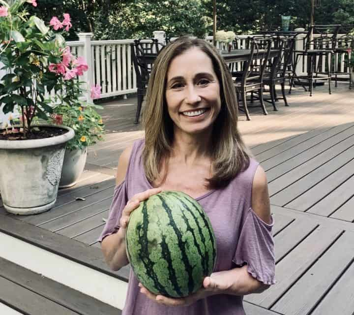 Chef Cindy holding an uncut watermelon