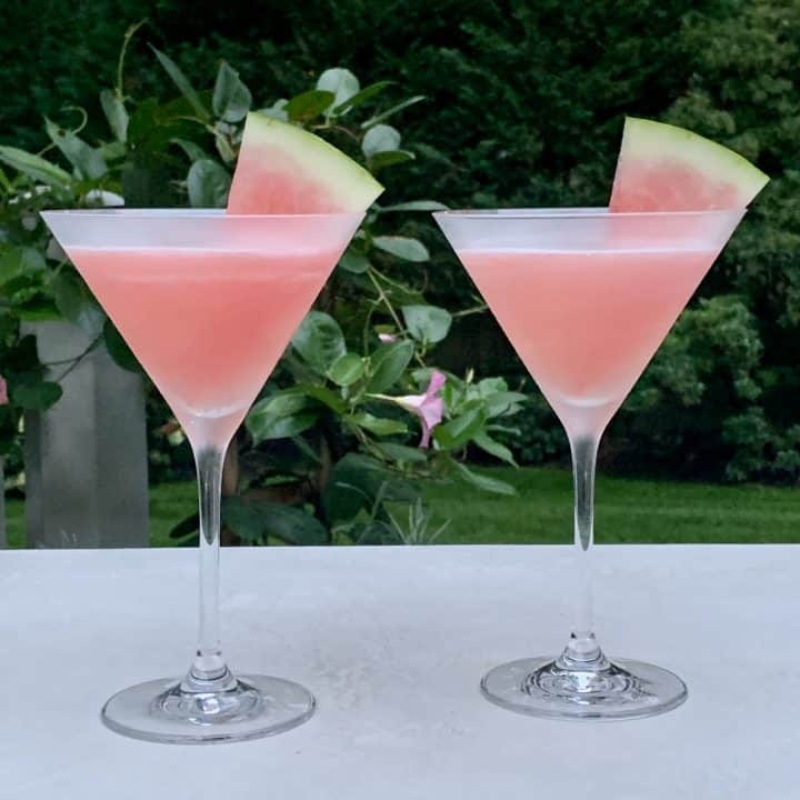 2 watermelon cosmo drinks with watermelon wedges