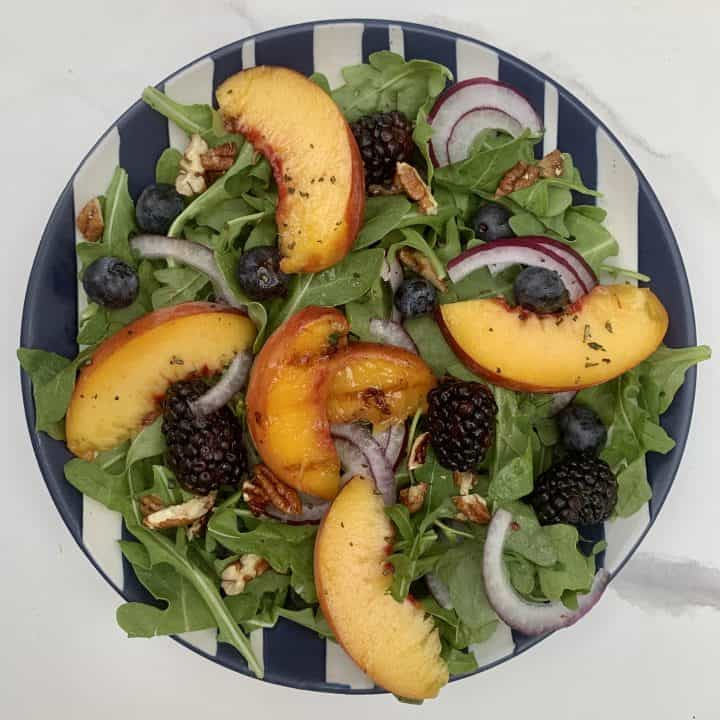 Grilled Peach Salad with Pecans beautifully plated topping with balsamic dressing