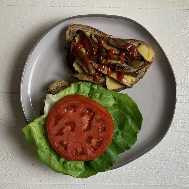 Vegan Shiitake BLT Sandwich with Almond Cheddar Cheese Sandwich open face on plate
