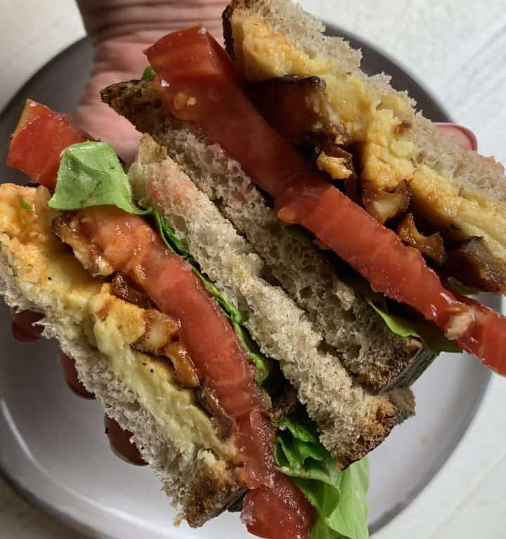 Vegan Shiitake BLT Sandwich sliced showing all the layered ingredients