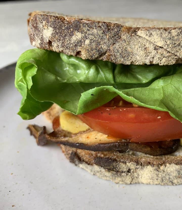 Vegan Shiitake BLT Sandwich with Almond Cheddar Cheese close up