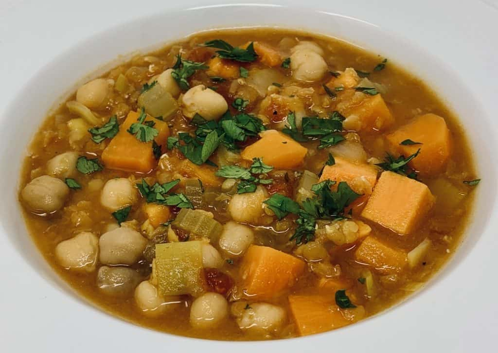 Sweet Potato, Chickpea and Red Lentil Soup close up topped with cilantro
