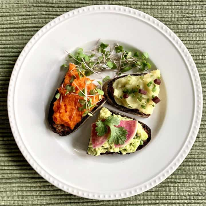Savory Breakfast Toast Trio together on a plate with microgreens