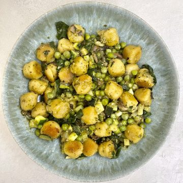 Cauliflower Gnocchi with Peas & Veggies in Bowl